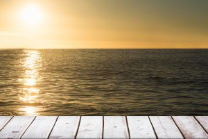digital composite of wooden boards with sea background